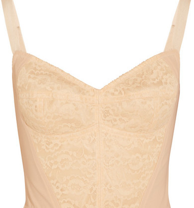 Wearing underwear as your outerwear-that`s the new trend! Dolce&Gabbana showed it on the Runway, now it`s your turn. This boned lace and stretch-mesh bustier offers you a feminine boost while the V-neck emphasizes your cleavage and give depth to your silhouette ( Top: Dolce&Gabbana, $795).