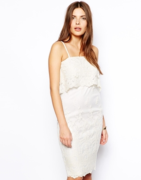 This empire-style layered lace cami dress makes it hard to tell where your hips begin and it looks so sweeet! ( Dress: Asos, $76.22).