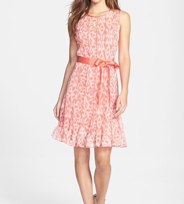 This light orange chiffon dress with a bow on the waistline and the floral pattern accentuate your hips and make you look very womanlike ( Dress: Eliza J., $98).