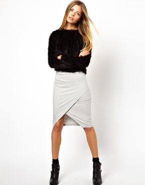 All eyes on waist: This diagonally-cut wrap-pencil skirt hugs your hips and falls loosely over your thighs. The grey color is an alternative to black yet is flattening because it is a neutral shade!( Skirt: Asos, $47.64)
